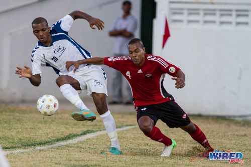 Photo: Trinidad and Tobago and Defence Force utility player Curtis Gonzales (right) in action against Martinique in the 2012 Caribbean Cup semi-finals. (Courtesy Allan V. Crane/ Wired868)