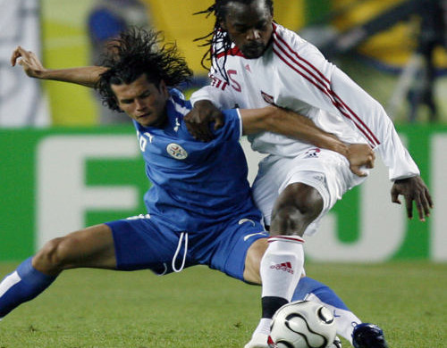 Photo: Former Trinidad and Tobago defender Brent Sancho (right) tussles for the ball against Paraguay at the 2006 World Cup.