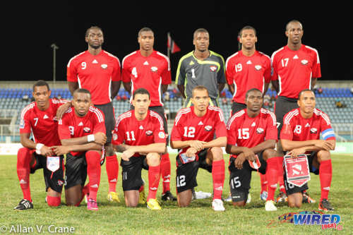 "Photo: The ""Soca Warriors"" prepare to face Peru in an international friendly at Couva last February. Kevon Carter is second from right in the front row. (Courtesy Allan V Crane/ Wired868)"
