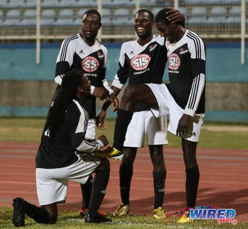 Photo: Central FC forward Rundell Winchester (far right) is congratulated by teammates (from left) Jason Marcano, Jamal Jack and Keion Goodridge during a Pro League contest. At present, Winchester is on loan to the reserve team of MLS franchise, Portland Timbers. (Courtesy Allan V Crane/Wired868)
