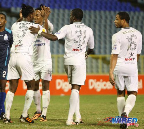 Photo: W Connection players (from left) Gerard Williams, Neil Benjamin Jr, Jerrel Britto and Shahdon Winchester celebrate during a previous league fixture. Connection made do with a 2-0 win today against St Ann's Rangers. (Courtesy Wired868)