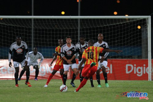 Photo: Point Fortin Civic attacker Marcus Joseph prepares to unleash a free kick against Central FC. Joseph's form with Connection earned him six national senior team caps. (Courtesy Allan V Crane/Wired868)