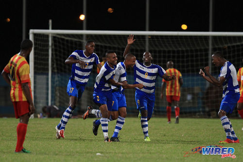 Photo: Defence Force players (from left) Ross Russell Jr, Curtis Gonzales, Balondemu Julius and Devorn Jorsling celebrate against Point Fortin Civic during the 2013/14 Pro League season. (Courtesy Allan V Crane/Wired868)