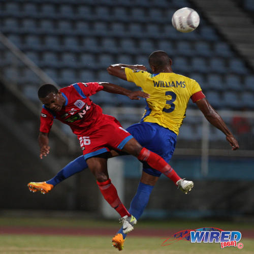 Photo: Veteran Defence Force utility player Keston Williams (right) wins an aerial challenge against 16-year-old St Ann's Rangers forward Josh Toussaint during 2014/15 Pro League action. (Courtesy Allan V Crane/Wired868)