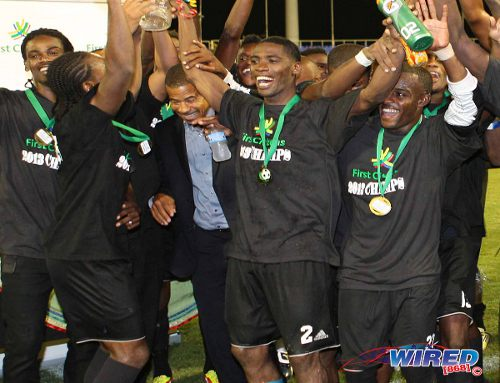 Photo: Central FC player Elton John (second from right) celebrates with his teammates after the club won the First Citizens Cup last year. (Courtesy Wired868)