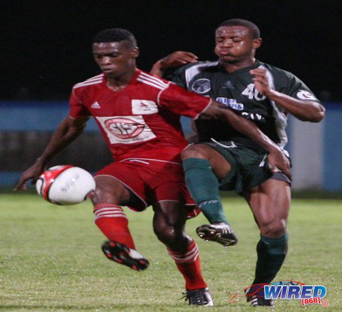 Photo: Central FC defender Elton John (left) keeps the ball from W Connection midfielder Jomal Williams. (Courtesy Wired868)