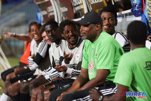 Photo: Central FC veteran Marvin Oliver (centre) and striker Willis Plaza (third from right) enjoy a light moment on the substitutes' bench during a Pro League outing in the 2013/14. (Courtesy Allan V Crane/Wired868)