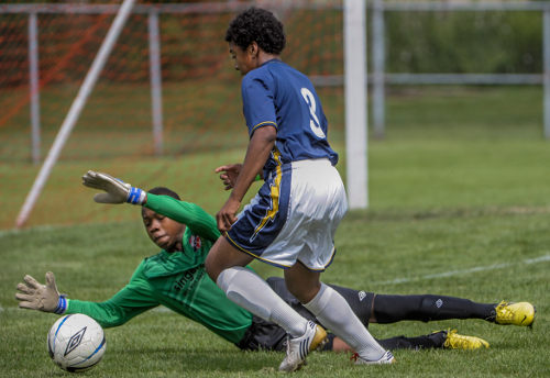 Photo: Two young men compete at the Robbie Soccer Tournament in Toronto, Ontario.