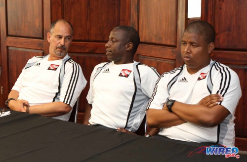 Photo: Trinidad and Tobago national head coach Stephen Hart (left) addresses the media with assistants Hutson Charles (centre) and Derek King during a press conference in June 2013. (Courtesy Wired868)