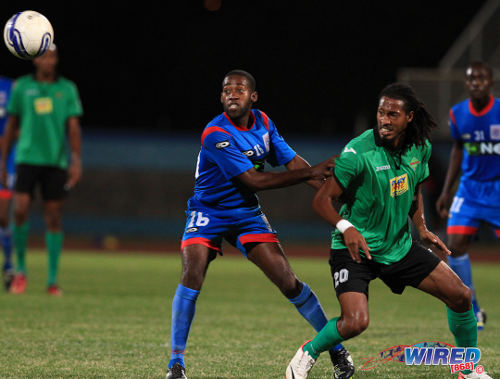 Photo: San Juan Jabloteh utility player Dwane James (right) and St Ann's Rangers midfielder Keron Alexander follow the ball. (Courtesy Allan V Crane/Wired868)