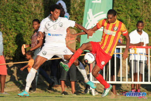 Photo: Point Fortin Civic defender Weslie John (right) hooks the ball away from W Connection attacker Jamal Clarence during Pro League action at Mahaica Oval. (Courtesy Allan V Crane/Wired868)