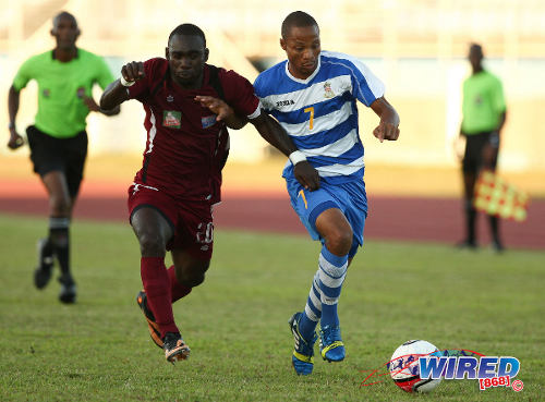 Photo: North East Stars striker Trevin Caesar (left) tries to burst past Defence Force attacker Balondemu Julius. Caesar left Tobago for Trinidad before breaking into the national set-up. (Courtesy Allan V Crane/Wired868)
