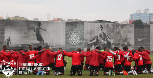 Photo: The Trinidad and Tobago national football team prays for teammate Marvin Phillip during practice today at the Corinthians training ground in Sao Paolo, Brazil. (Courtesy Allan V. Crane/TTFA Media)