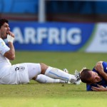 Italy bites the dust; Suarez makes a meal of Chiellini