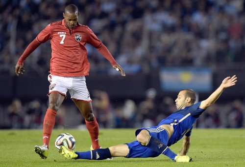 Photo: Trinidad and Tobago midfielder Ataulla Guerra (left) takes on Argentina midfielder Javier Mascherano during a friendly on 4 June 2014. (Copyright AFP 2014/Daniel Garcia)
