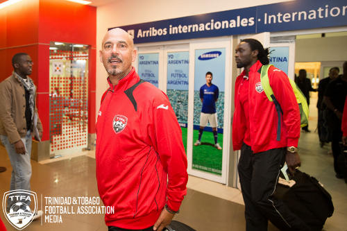 Photo: Trinidad and Tobago national football head coach Stephen Hart (centre) and captain Kenwyne Jones (right) land in Buenos Aires for a June 4 friendly against Argentina. (Courtesy Allan V Crane/TTFA)