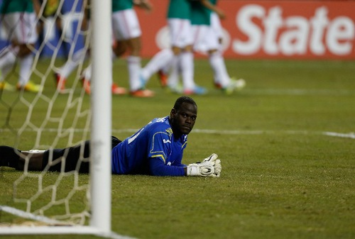 Photo: Trinidad and Tobago goalkeeper Jan-Michael Williams muses over Mexico's decisive goal in the 2013 CONCACAF Gold Cup quarterfinal. (Copyright Getty Images/AFP/ Mike Zarrilli)