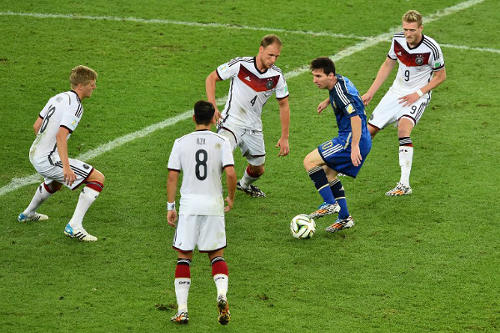 Photo: Argentina captain Lionel Messi (second from right) looks for a way past Germany players Andre Schuerrle (far right). Benedikt Hoewedes (centre), Mesut Özil (second from left) and Toni Kroos. He couldn't beat four Germans?! Clearly, the boy is overrated! (Copyright AFP 2014/Gabriel Bouys)