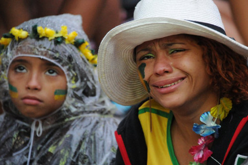 Photo: Brazil football fans celebrate then Trinidad and Tobago prime minister Kamla Persad-Bissessar's visit to Belo Horizonte. Too bad about the 7-1 loss to Germany which, coincidentally, happened on that same day... (Copyright AFP 2014/Tasso Marcelo)