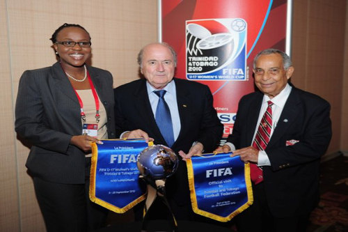 Photo: Former TTFF president Oliver Camps (right), outgoing FIFA president Sepp Blatter (centre) and 2010 LOC deputy CEO Nataki Kerr. (Courtesy TTFA)