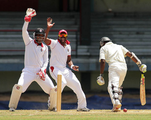 Photo: Denesh Ramdin (left) and Dwayne Bravo (centre) appeal for a catch while on Trinidad and Tobago cricket duty.
