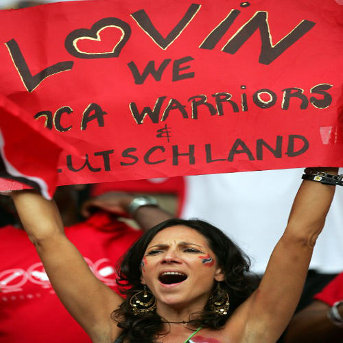 Photo: A Trinidad and Tobago supporter holds up a sign ahead of the Group B World Cup match between Paraguay and Trinidad and Tobago at Kaiserslautern's Fritz-Walter Stadium on 20 June 2006. (Copyright AFP 2014/Roberto Schmidt)