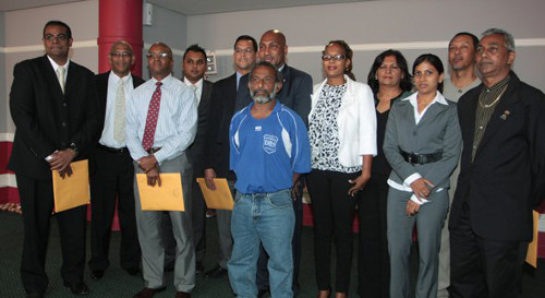 Photo: Sport Minister Anil Roberts and permanent secretary Ashwin Creed pose with the initial SPORTT board in 2010. The board members still there are Dr Anyl Goopeesingh (far left), Matthew Quamina (third from left), Kent Samlal (fourth from left), Nisa Dass (third from right), Caryl Kellar (second from right) and Milton Siboo (far right). (Courtesy Trinidad Guardian)