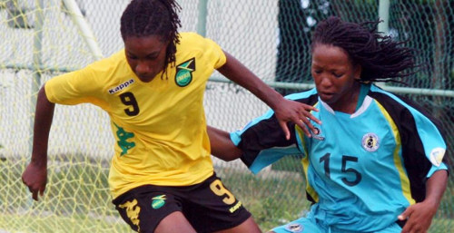 Photo: Jamaica striker Shakira Duncan takes on a St Lucian opponent in a previous contest. Duncan was a constant threat last night. (Courtesy CONCACAF)