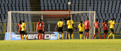 Photo: Trinidad and Tobago goalkeeper Kimika Forbes pushed an effort over bar during the Caribbean Cup final against Jamaica. (Courtesy Jinelle James/WOLF)
