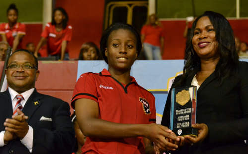 Photo: Trinidad and Tobago attacker Mariah Shade (centre) collects her Caribbean Cup MVP award from CFU executive member Sonia Bien-Aime (right) while CFU president Gordon Derrick looks on. (Courtesy Jinelle James/WOLF)