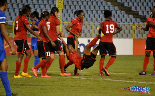 Photo: Trinidad and Tobago goal scorer Dernelle Mascall (centre) gets a lift back to the centre circle from teammates Kennya Cordner (second from right), Tasha St Louis (third from right) and Arin King (fourth from right) during the 2014 Caribbean Cup. (Courtesy Jinelle James/Wired868)