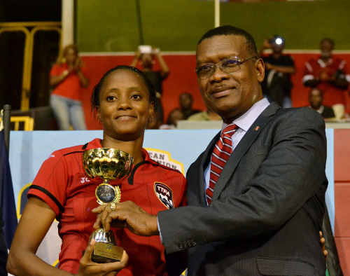Photo: Trinidad and Tobago attacker Tasha St Louis (left) collects her prize as Caribbean Cup top scorer from TTFA president Raymond Tim Kee. (Courtesy Jinelle James/WOLF)