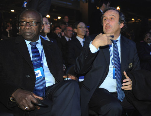 Photo: Ex-FIFA VP Jack Warner and UEFA president Michel Platini keep each other's company at a FIFA event.