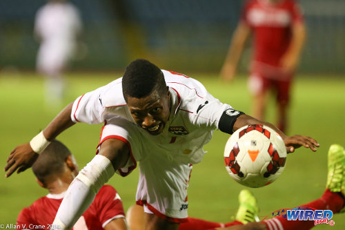 Photo: Trinidad and Tobago National Under-20 captain and right back Shannon Gomez (right) battles for possession against Cuba during the 2014 Under-20 Caribbean Cup. (Courtesy Allan V Crane/Wired868)