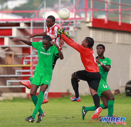 Photo: St Anthony's College attacker Kwesi Allen (second from left) heads past San Juan North Secondary goalkeeper D'Eandre Villaroel during Big Four action at Westmoorings. (Courtesy Allan V Crane/Wired868)