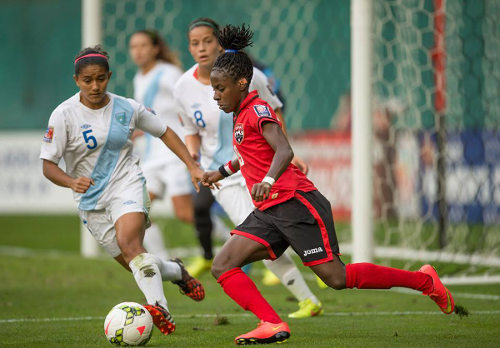"Photo: Trinidad and Tobago star Kennya ""Yaya"" Cordner (right) runs at the Guatemala defence during the 2014 CONCACAF Championship. (Courtesy CONCACAF)"