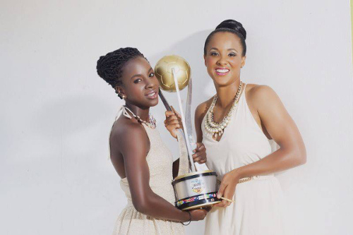 "Photo: Trinidad and Tobago international football stars Kennya ""Yaya"" Cordner (left) and Maylee Attin-Johnson pose with the 2014 Caribbean Cup trophy. (Copyright Kerron Riley)"