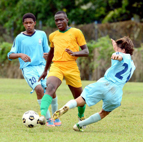Photo: St Augustine Secondary captain Joshua Marshall (centre).