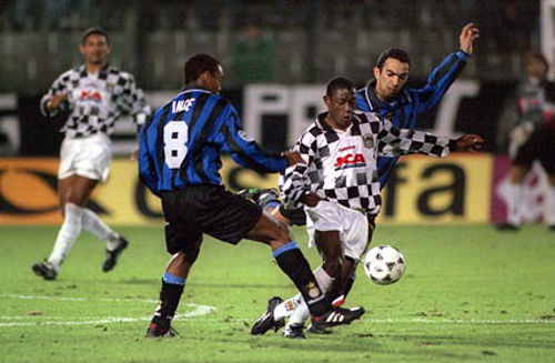 Photo: Trinidad and Tobago playmaker Russell Latapy (centre) shows off his dribbling ability for Portuguese club Boavista against Italy's Inter Milan in European competition. His victims here are former England captain Paul Ince (left) and France World Cup winner Youri Djorkaeff.
