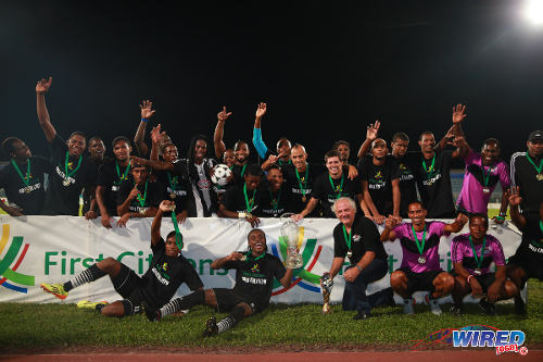 Photo: Central FC celebrates its 2014 First Citizens Cup title after a 1-0 final win over North East Stars in Couva. (Courtesy Allan V Crane/Wired868)