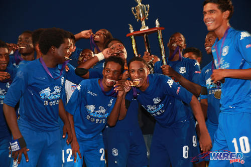 Photo: Naparima College players (from left) Jarred Dass, Nicholas Thomas, Martieon Watson and Justin Sadoo celebrate their Big Four success. (Courtesy Allan V Crane/Wired868)