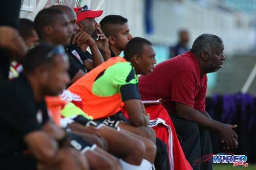 Photo: St Anthony's College coach Nigel Grosvenor (right) looks on from the bench during their Big Four fixture against Naparima College at the Mannie Ramjohn Stadium, Marabella. (Courtesy Allan V Crane/Wired868)