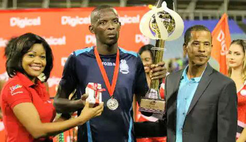 Photo: Police FC's Jameel Perry holds the 2014 Digicel Pro Bowl Most Goals trophy. (Courtesy TT Pro League)