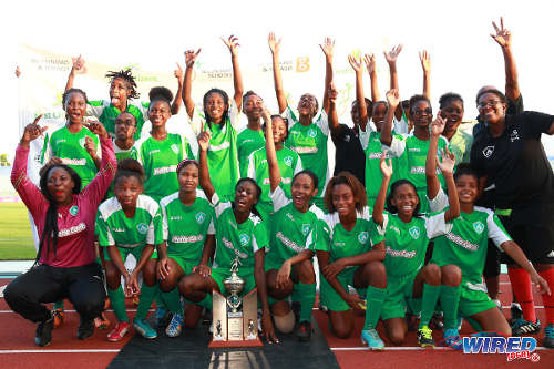 Photo: St Augustine Secondary footballers celebrate with the 2014 Girls' National Intercol trophy. (Courtesy Allan V Crane/Wired868)
