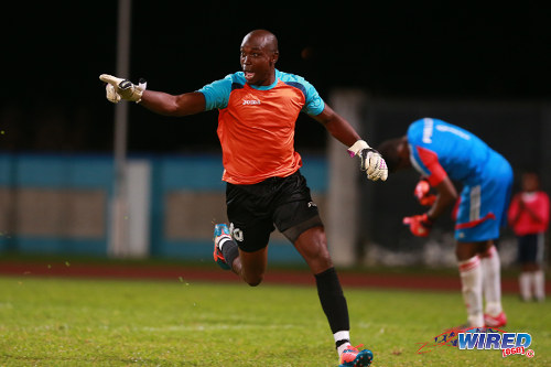 Photo: San Juan Jabloteh' goalkeeper Shane Mattis (left) celebrates his winning penalty save against Point Fortin Civic in the 2014 Toyota Classic final. (Courtesy Allan V Crane/Wired868)