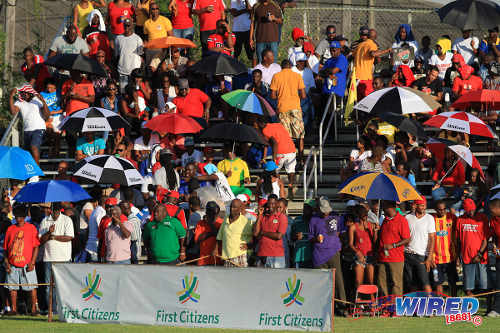 Photo: Point Fortin Civic supporters cheer on their team at the Mahaica Oval in Point Fortin. The Mahaica ground lacks lighting, a covered stand or adequate bathroom facilities. (Courtesy Allan V Crane/Wired868)