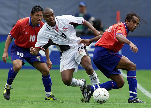 Photo: Trinidad and Tobago striker Jerren Nixon (centre) tussles with Costa Rican players Mauricio Wright (left) and Jafet Soto during the 2000 CONCACAF Gold Cup quarterfinal. Trinidad and Tobago won 2-1 in extra time. Nixon played under St Augustine coach Kenny Thomas as a schoolboy. (Copyright AFP 2015/Hector Mata)