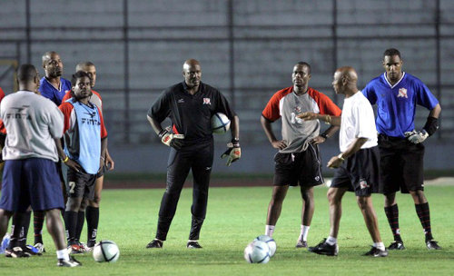 Photo: Coach Bertille St Clair (second from right) has a word with (from right) Shaka Hislop, Stern John, Michael Maurice, David Nakhid, Leslie Fitzpatrick and Clayton Ince during his stint with the Trinidad and Tobago National Senior team. (Copyright AFP 2015)
