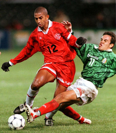 Photo: Trinidad and Tobago captain David Nakhid (left) tries to avoid a tackle from Mexico star Chauhtemoc Blanco during the 1998 CONCACAF Gold Cup. (Copyright CONCACAF 2015)
