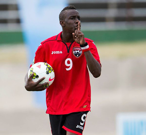 Photo: Trinidad and Tobago striker Kadeem Corbin celebrates his strike against Aruba in the 2015 CONCACAF Under-20 Championships in Jamaica. He was booked for the gesture by Bahamian official Randolph Harris. (Courtesy CONCACAF)
